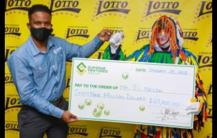 Stefan Miller (left) celebrates with the first Lotto winner for 2021, D. Nelson, who copped a jackpot of $69 million, did it with the lucky numbers 07, 09, 14, 17, 30 and 33 on January 6.
