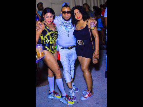 Noxroy (centre), a promoter of Shoes Game, chills with  Stacey (left) and Chudups.
